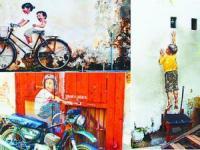 老墙面上绘生活 引路马来西亚槟城(图)